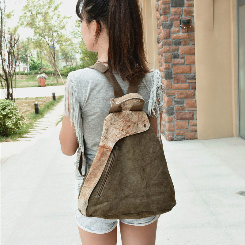 New Canvas Womens Backpack Leisure Travel Multi-function Bag Creative Cowhide Canvas Stitching BackpackNew Canvas Womens Backpack Leisure Travel Multi-function Bag Creative Cowhide Canvas Stitching Backpack