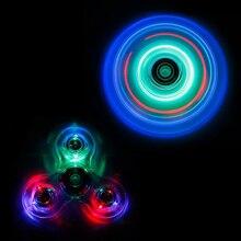LEDใสTri-s Pinnerอยู่ไม่สุขปั่นพลาสติกEDCสำหรับออทิสติกและสมาธิสั้นมือเหยื่อเกมกระดาน