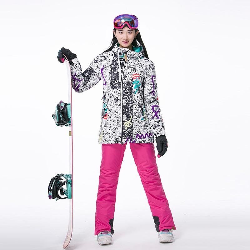 Prix pour Professionnel Femme Sports de Plein Air Coupe-Vent Imperméable À Capuche Neige Costumes Dame Thermique Snowboard Ski Veste + Pantalon à Bretelles