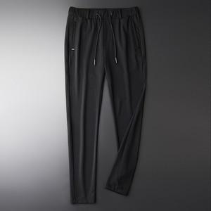 Image 2 - Pantalones de hombre transpirables de tela ahuecada de linglu nuevo verano Delgado negro cómodo pantalones de hombre de talla grande M XL 2XL 3XL 4XL