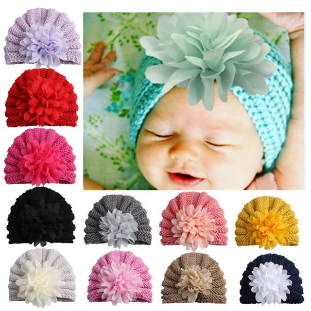 de96139deb8 on sale 1pcs 2017 Baby Knitting Hat Photography Accessories Girl Flower  india Cap Touca Infantil