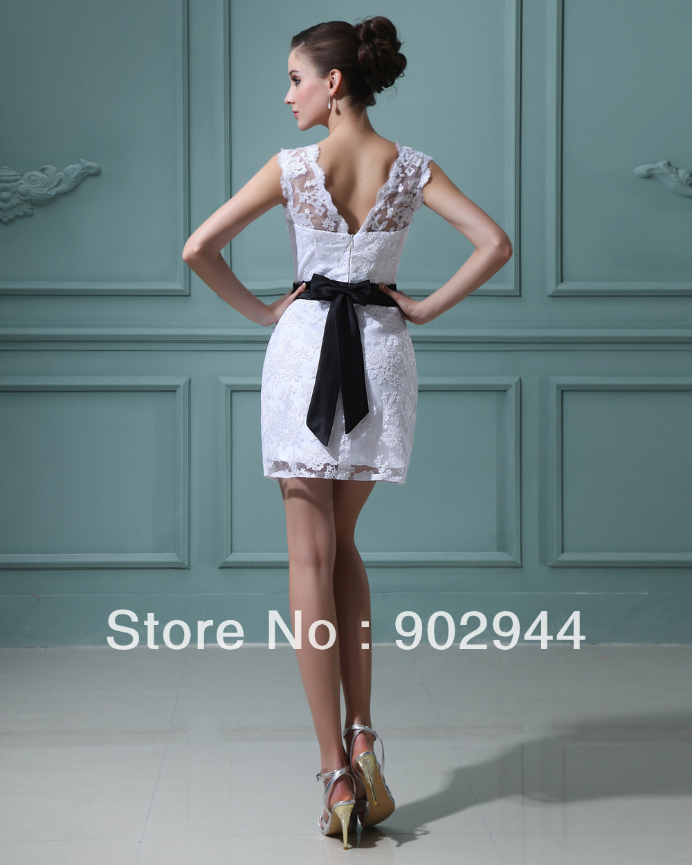 White dress with black lace belt