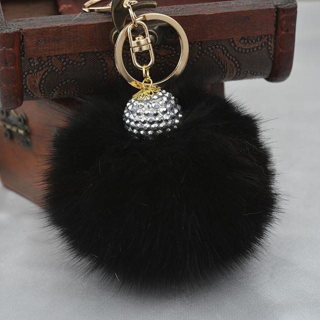 Marca negro de piel de zorro Pom Pom bola de la muñeca llavero karlito encanto del bolso llavero de peluche para el coche bolsa colgante anillo