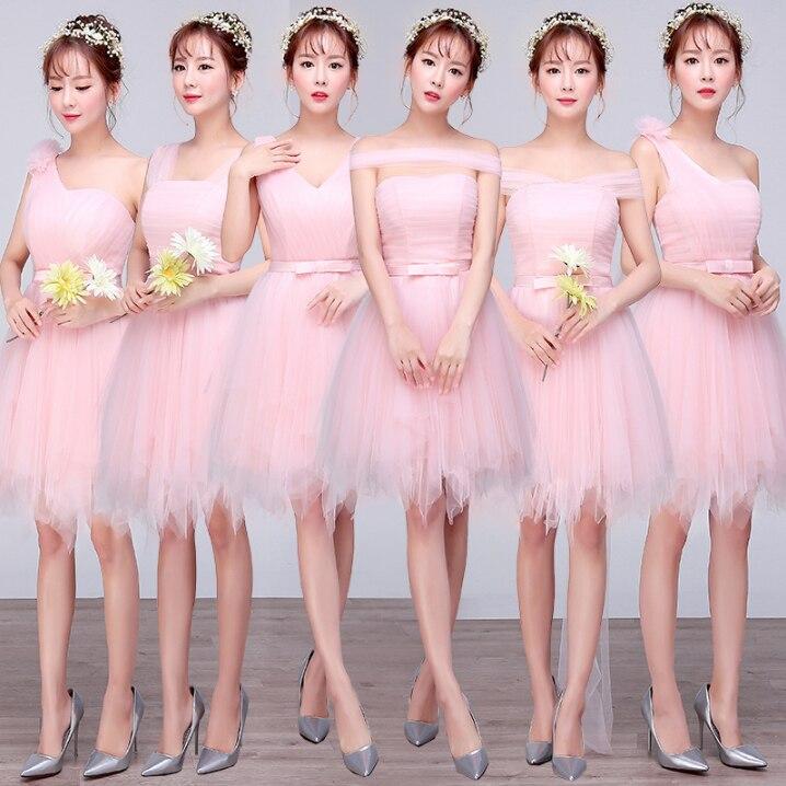 Sin tirantes rosa claro de las muchachas sin tirantes fuera del ...