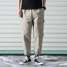 купить Summer New Harem Pants Men Fashion Casual Multi-pocket Overalls Man Streetwear Hip-hop Loose Joggers Sweatpants Male M-5XL по цене 1413.02 рублей