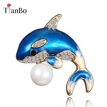 Chegada nova Esmalte Bonito Golfinho Azul Casaco de Inverno Chapéu Pinos  Broche Broches para As Mulheres b51f77b0b6e