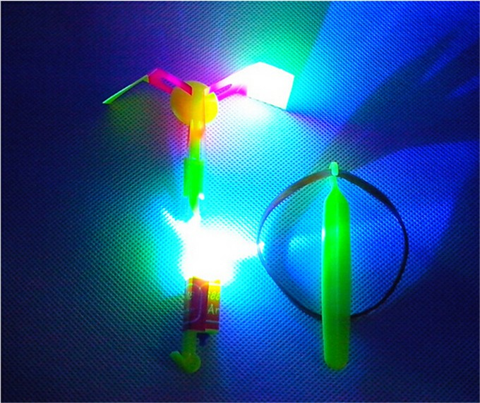 12Pcs Amazing Led Light Arrow Rocket Helicopter Flying Toy Led Light Flight