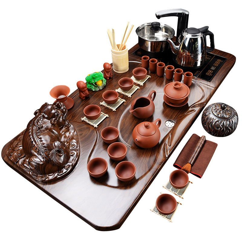 Semi-automatic Lazy Zisha Kungfu Tea Set Solid Wood Tea Plate Four in One Electromagnetic Furnace SetSemi-automatic Lazy Zisha Kungfu Tea Set Solid Wood Tea Plate Four in One Electromagnetic Furnace Set