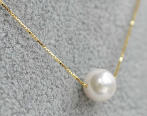 Gros hot > > > > 10 MM mer naturel sud une véritable blanc ronde chance perle collier pendentif