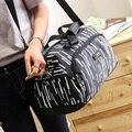 Mulheres homens Viajar Sacos de 2017 Nova Poliéster Ocasional Sacos de Ombro Bolsa Grande Capacidade de Bagagem Duffle Sacos de Viagem De Qualidade