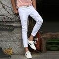 Hot 2016 Branco Rasgado calças de Brim Dos Homens Com Buracos Cowboy Super Skinny famoso Designer Da Marca Slim Fit Jean Destruído Rasgado Calças Para Homens