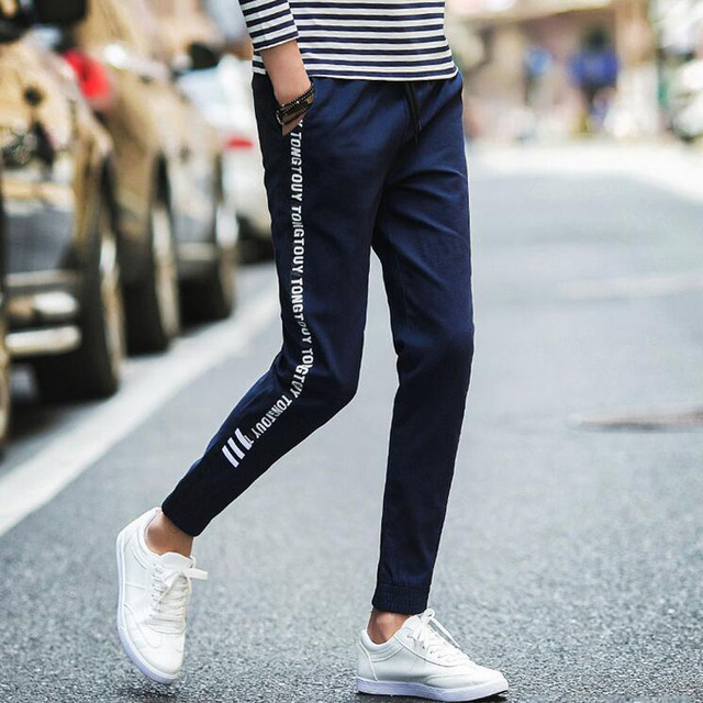 Fashion street style or jogging sport pants men outdoors ...