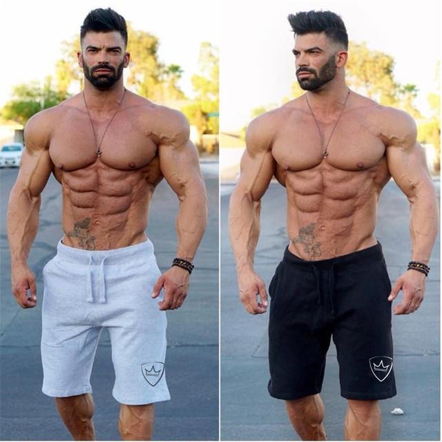 חדש אופנה גברים ספורט Beaching מכנסי כותנה פיתוח גוף מכנסי טרנינג כושר קצר Jogger מקרית חדרי כושר מכנסי התעמלות