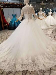 Image 3 - LSS047 élégante robe de mariée ivoire col rond à manches longues à lacets dos musulman vestido madrinha de casamento longo