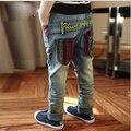 Синий дети 2015 новых тощий известный мальчик бренд середина эластичный пояс печать брюки Stonewashed для мальчика синий дети джинсы