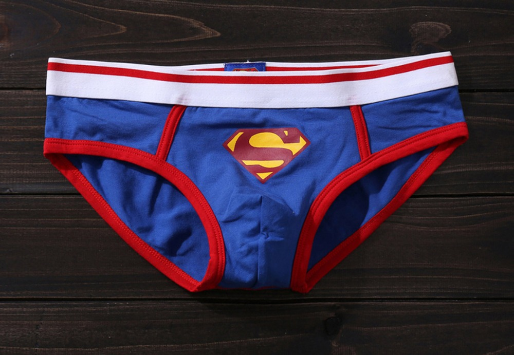 Superman Clark Kent the Reporter Boxer Briefs. These 95% cotton/ 5% spandex boxer briefs for men feature action shots of Superman and his secret identity as the mild-mannered reporter at the Daily Planet, Clark Kent. Machine washable with exposed 'Action Comics' elastic waistband.