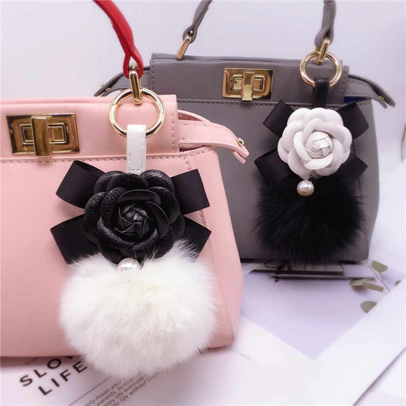 2019 Nova criativo Camellia arco senhoras pele de raposa bola chaveiro chave anel saco de ornamentos de moda pingente