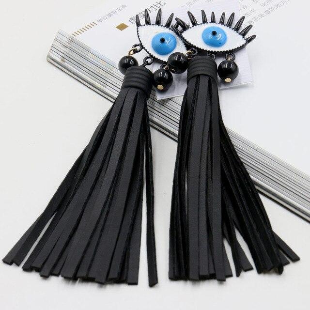 New outono/inverno new Coréia camisola cadeia herdeira ventilador preto couro borla brincos longos moda olho 765