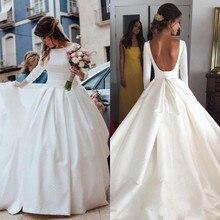 2019 Backless Wedding Dresses Bll Gown Vintage Scoop Long Sleeves Satin Bridal  Gown Open Back Simple Design Bride Reception Wear 4c5c36c193bb