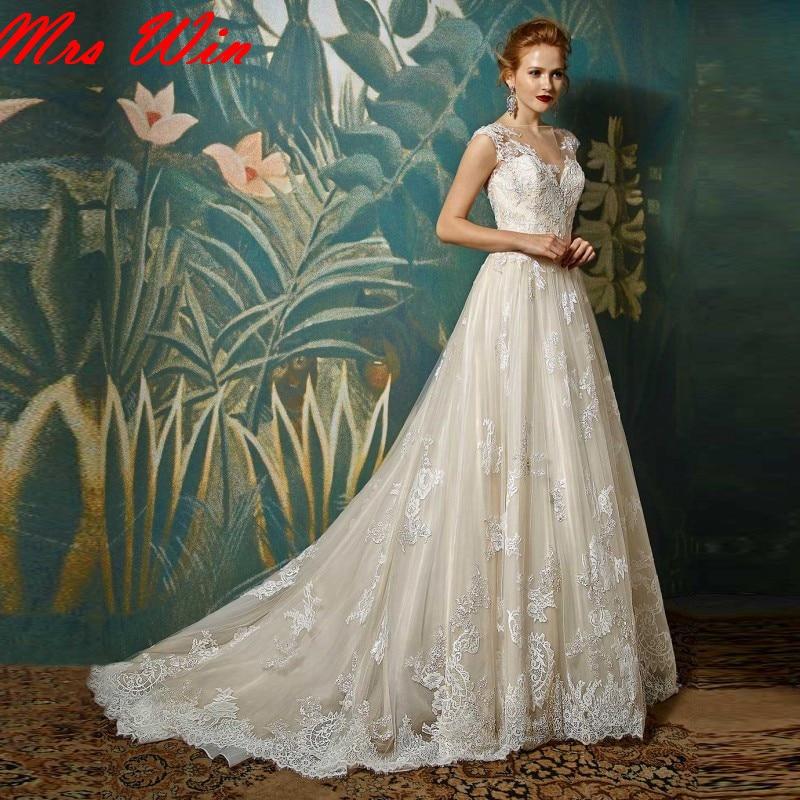 Gorgeous Applique Lace Wedding Dresses 2017 See Through Back Wedding ...