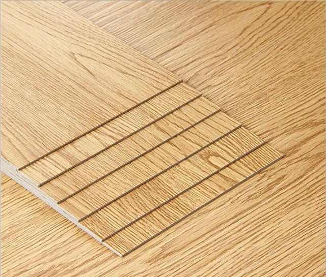 Environmental Protection PVC Floor Tile Sound Absorbing Noise Wood Grain Abrasion Resistant Adhesive Plastic