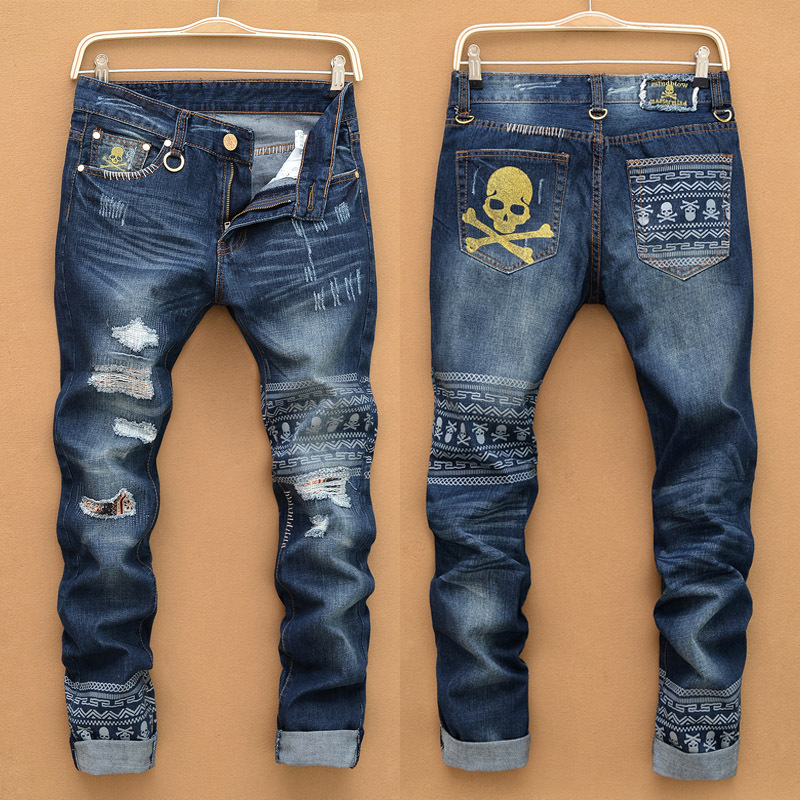 1e0b594610acf Famosos hombres de la marca de moda nuevos agujeros en vaqueros para hombre pantalones  vaqueros rasgados versión rectos delgados cal baggy desgastados ...