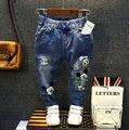 2016 niños niñas niños vaqueros pantalones de Mickey pantalones largos de mezclilla para el niño de la muchacha Denim impresión agujero Retro vintage