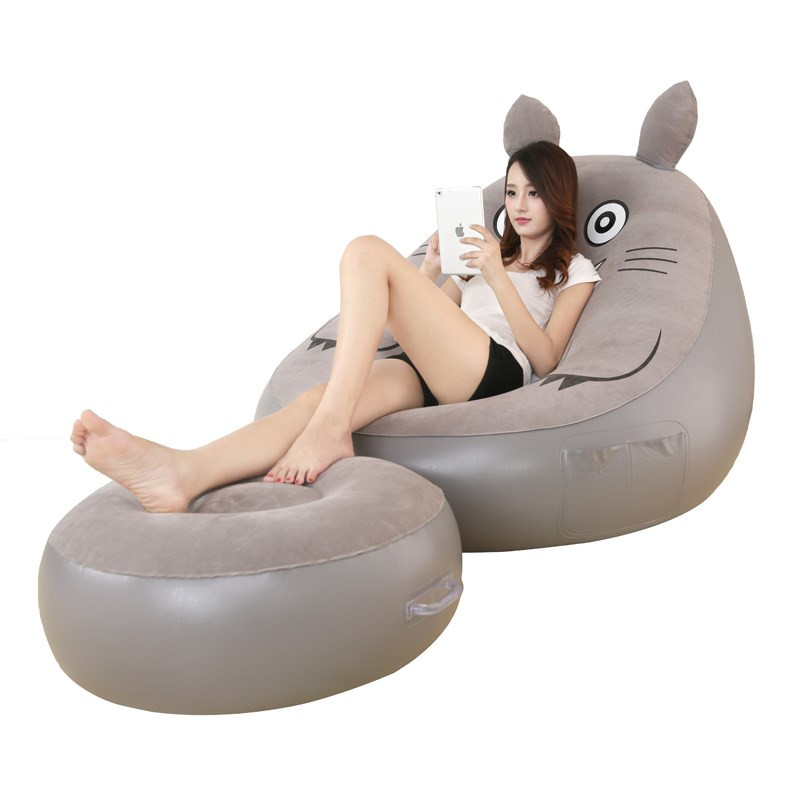 Posing On A Blow Up Chair She Masturbates With A Toy After Sucking It