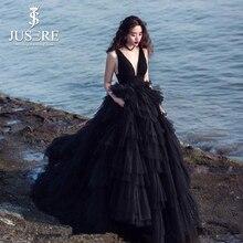 87fae4b10 Negro elegante una línea Sexy V escote con gradas espalda abierto falda con  gradas de Tulle Red Formal Prom señora noche vestido.
