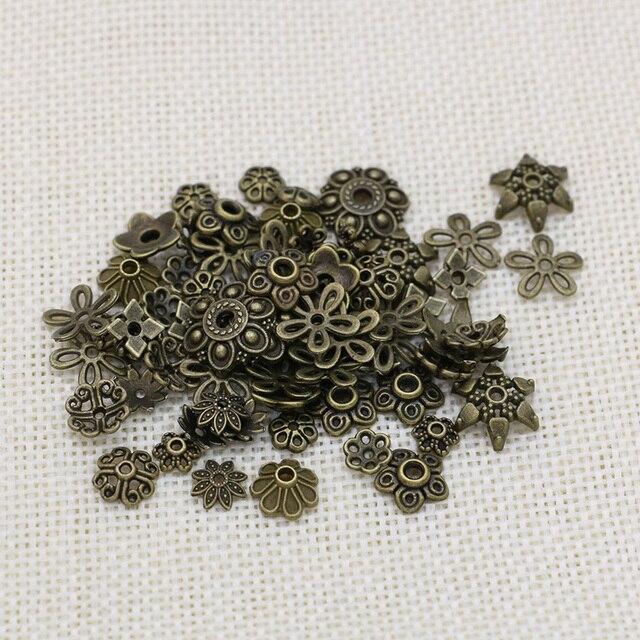 190fe46abc6f Gorras de cuentas de flores chapadas en bronce antiguo mixto para hacer  joyas accesorios de pulsera