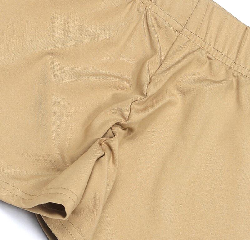 Short de compression pour femme beige à plat