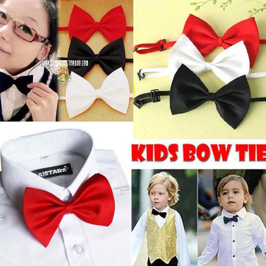 Commercio all'ingrosso Capretti Dei Bambini Bow Tie 20 Colori Solidi Farfalla Pianura Per Smoking Banchetto di Nozze Di Compleanno di Promenade Costumi Regalo Archi