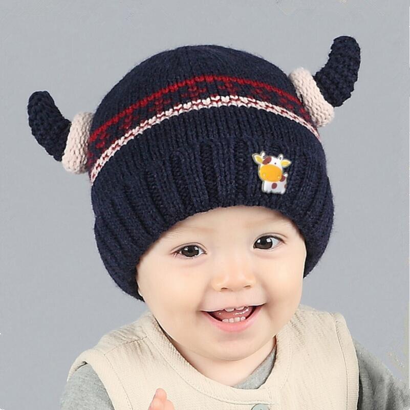 Nouveau 2016 bleu foncé tête de vache bébé chapeau d hiver garçons chapeaux  skullies bonnets enfant en bas âge enfants chapeau pour bébé fille enfants  ... 8438bee605c