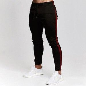Image 5 - Pantalons de Jogging rouge hommes rayé Sport pantalons de survêtement pantalons de course pantalons de gymnastique hommes coton survêtement Fitness survêtement pantalon de musculation