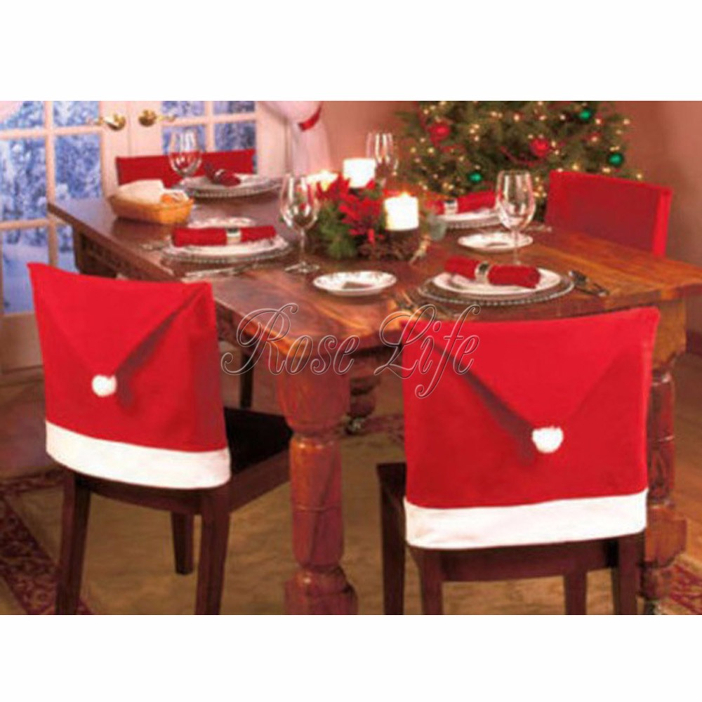 Christmas chair back covers - 4pcs Lot Christmas Chair Covers Santa Clause Red Hat For Dinner Decor Home Decorations Ornaments