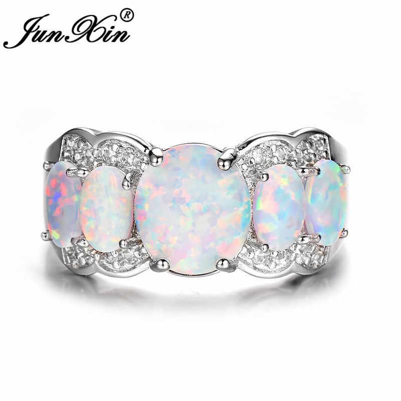 JUNXIN 925 สีเงินหรูหราแท้รูปไข่ใหญ่สีขาวโอปอลไฟแหวนสำหรับผู้หญิงฝังคริสตัลสายรุ้ง Birthstone แหวน