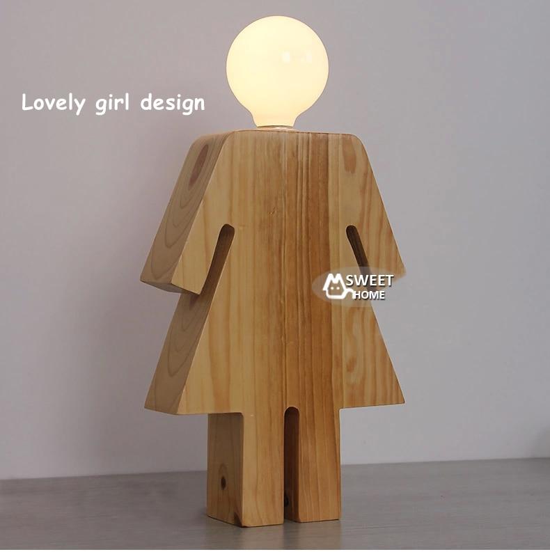 Diseño de la novedad del muchacho y de la muchacha lámpara de escritorio base de madera.jpg