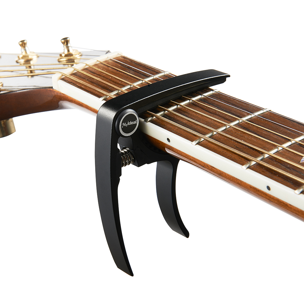 popular guitar capo buy cheap guitar capo lots from china guitar capo suppliers on. Black Bedroom Furniture Sets. Home Design Ideas