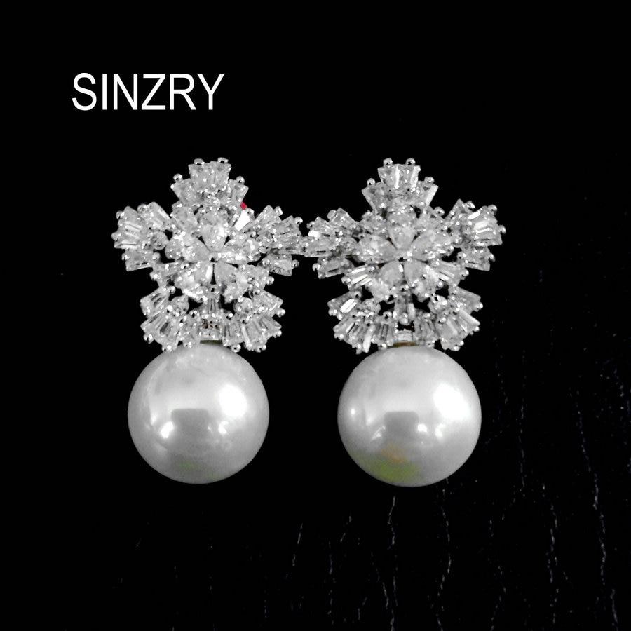 Sinzry hotsale elegant brilliant cut cubic zircon snowflake simulated pearl stud earrings wholesale Korean jewelry