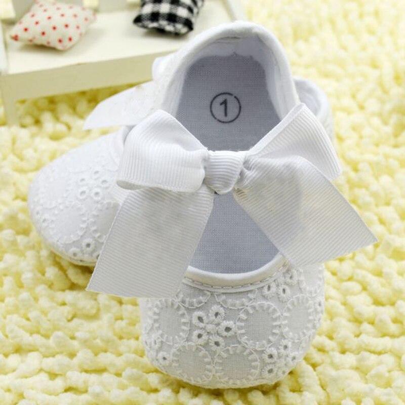 Blanco bowknot del cordón del bebé zapatos del niño de prewalker antideslizante