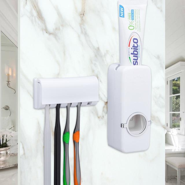 ชุดอุปกรณ์ห้องน้ำแปรงสีฟัน Automatic Toothpaste Dispenser ผู้ถือแปรงสีฟัน Wall Mount Rack ห้องน้ำชุดเครื่องมือ