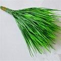 Venta caliente nuevo 7 tenedor hierba verde flores artificiales plantas flores de plástico decoración del hogar fiesta decoración de la habitación del hogar