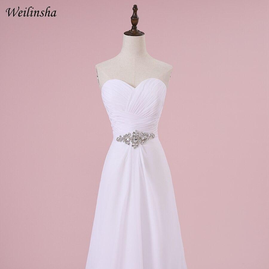 a linha plissados branco marfim vestidos de