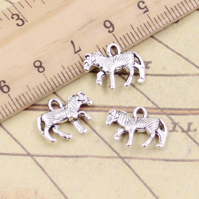 Zebra earrings Zebra Jewelry Zebra lover. Zebra gifts Zebra earrings in silver toned metal