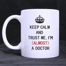Mug Coffee Cup Porcelain Tea Mug with handleKeep Calm And Trust Me,I'm(almost)A Doctor Ceramic 11 Oz,White printio keep calm and trust me cup