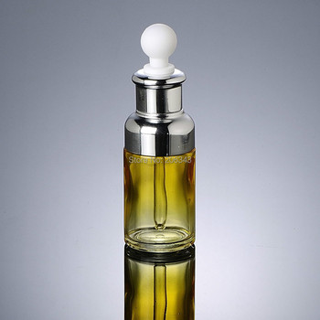 NEW ARRIVAL 50ml  yellow   glass dropper  bottle  with silver shoulder and silver collar ,white bulb  glass bottle