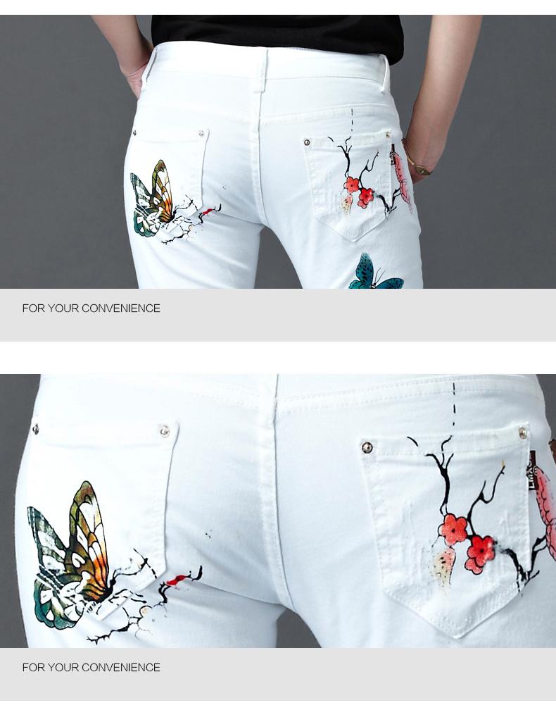 Valged teksapüksid liblikatega