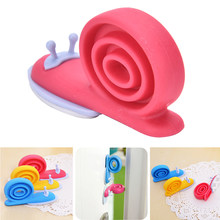 1pc Soft Plastic Baby Home Safety Door Stopper Protector Children Safe Snail Shape Door Stops Baby gate corner protector(China)