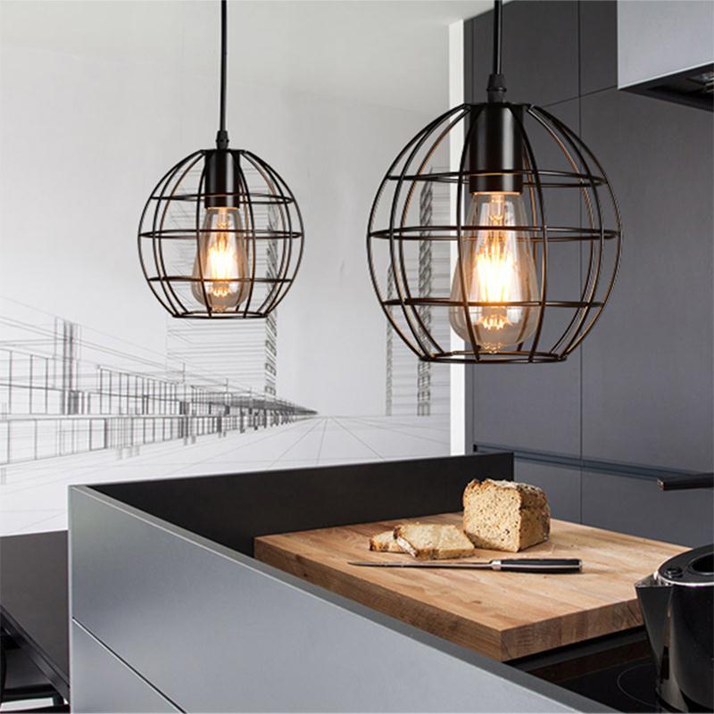 Brushed Copper Hanging Light Over Kitchen Sink