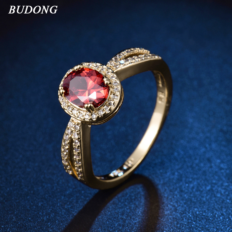 BUDONG 2017 Top Fashion Halo Ladies Finger Band Gold Color Ring for Women Oval Red Crystal Zirconia Engagement Jewelry XUR341